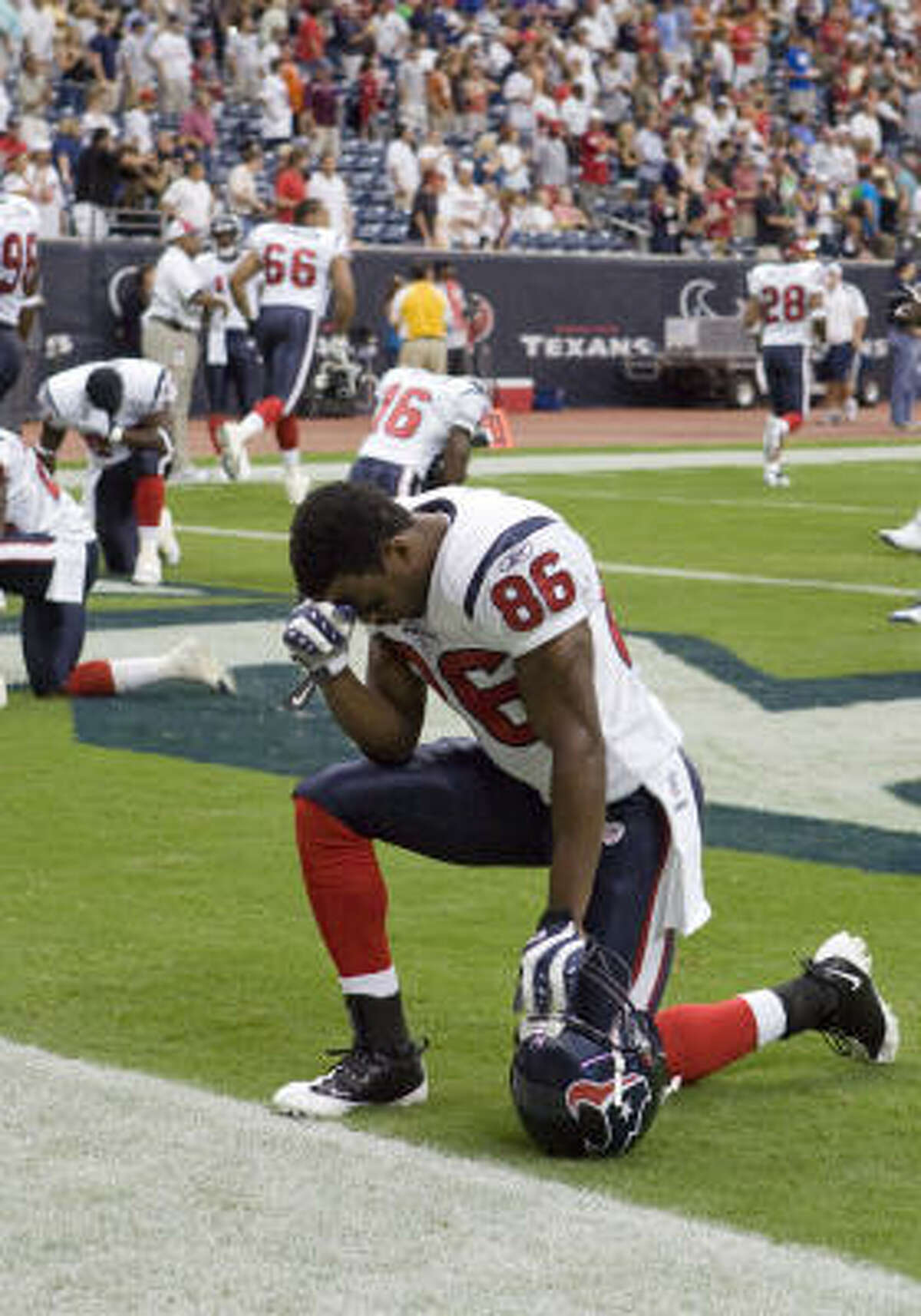 Texans receiver Harry Williams (86) and defensive lineman Cedric Killings both saw their careers end in sudden, frightening fashion because of wedge-related neck injuries last season.