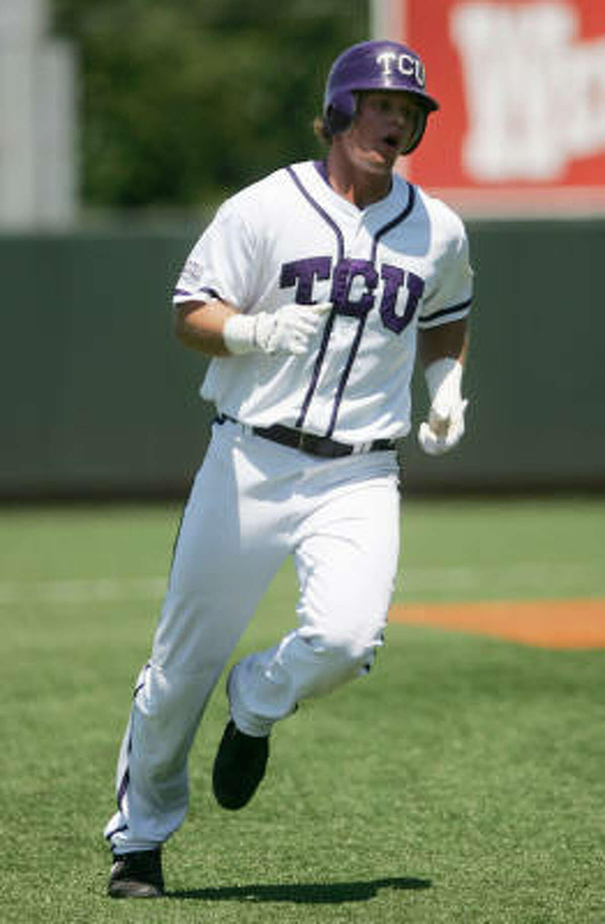 TCU's Matt Vern rounds second base after hitting a two-run home run in the fourth inning.