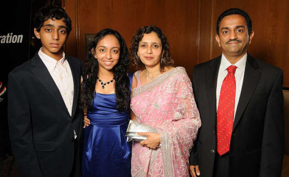From left: Gaurav, Mahime, Asha and Pankaj Dhume Photo: Dave Rossman, For The Chronicle