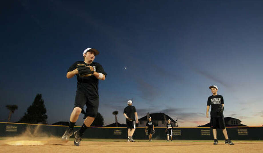 Beau Orlando, front, runs a double play drill as he and the rest of the Pearland Little Leaguers prepare to represent the Southwest Region in the Little League World Series. The team practiced Friday night at the Dad's Club Community Park in Pearland. Photo: Nick De La Torre, Chronicle