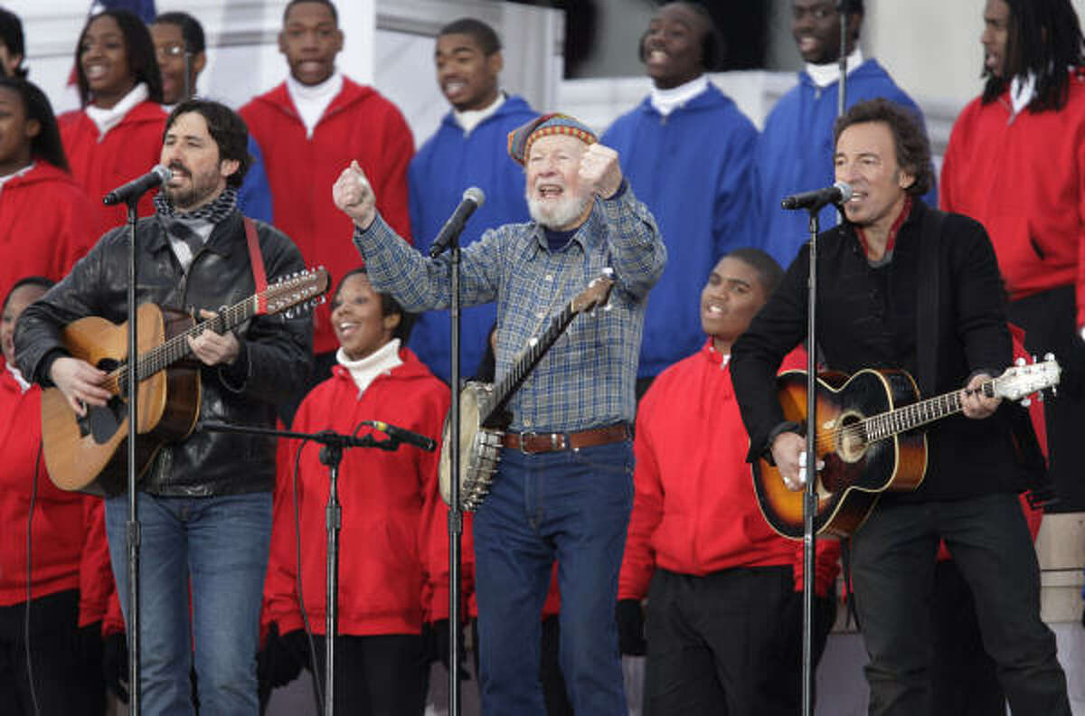 Pete Seeger, center, Bruce Springsteen, right, and Seeger's grandson Tao Seeger, perform during the