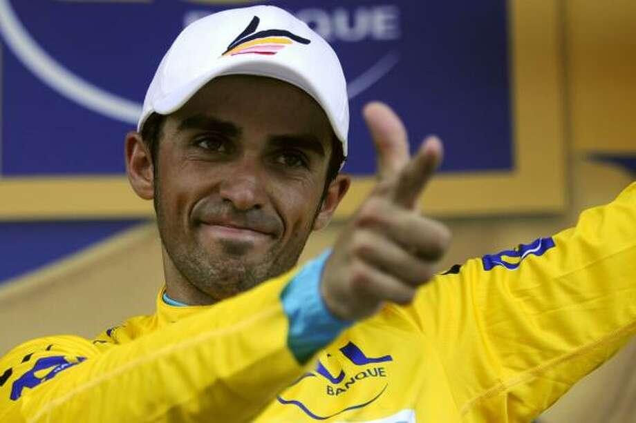 Spain's Alberto Contador, makes his pistolero gesture on the podium after taking over the yellow jersey as the overall leader. Photo: LIONEL BONAVENTURE, AFP/Getty Images