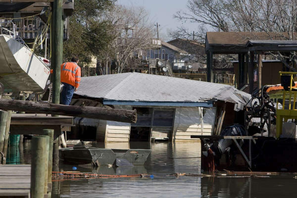 Dan Rackard, marine operations manager with CrowderGulf, examines a San Leon canal on Wednesday. The group is surveying the debris Hurricane Ike left in Galveston Bay.