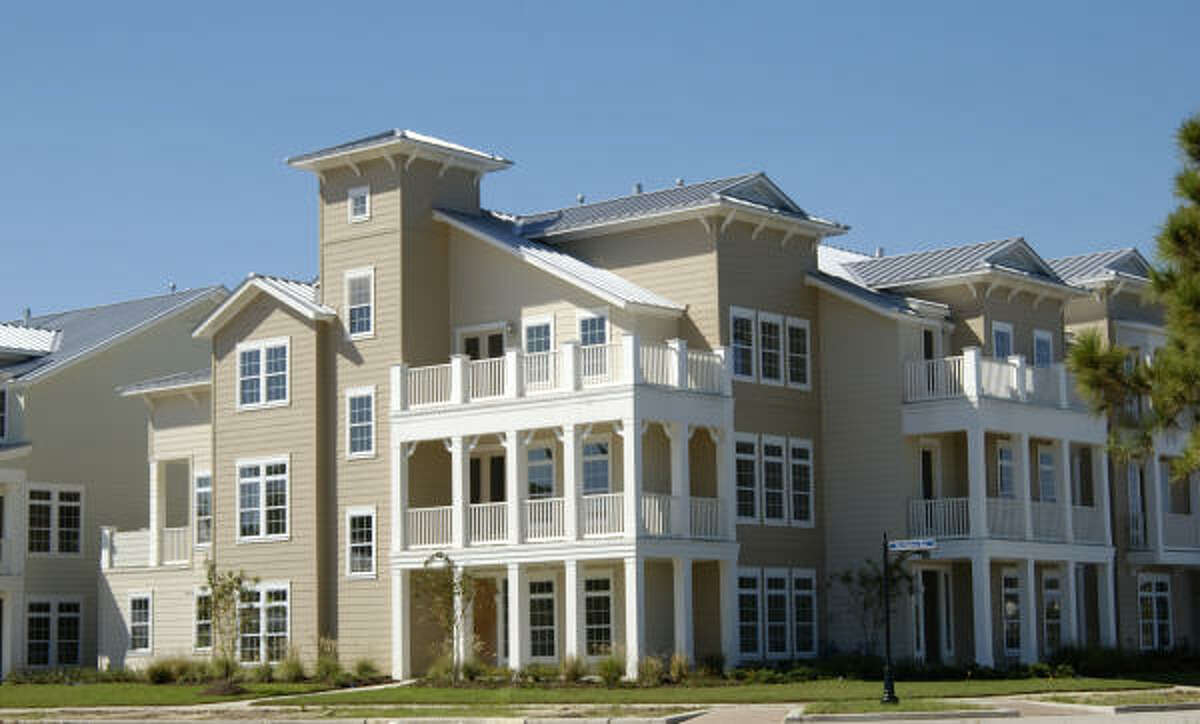 ALONG THE SHORE: East Shore is on the eastern edge of 200-acre Lake Woodlands. McVaugh presents Oasis Pointe Condominiums and Townhomes, priced from the $390,000s. McVaugh's condominiums and three-story townhomes feature Southern coastal architecture.