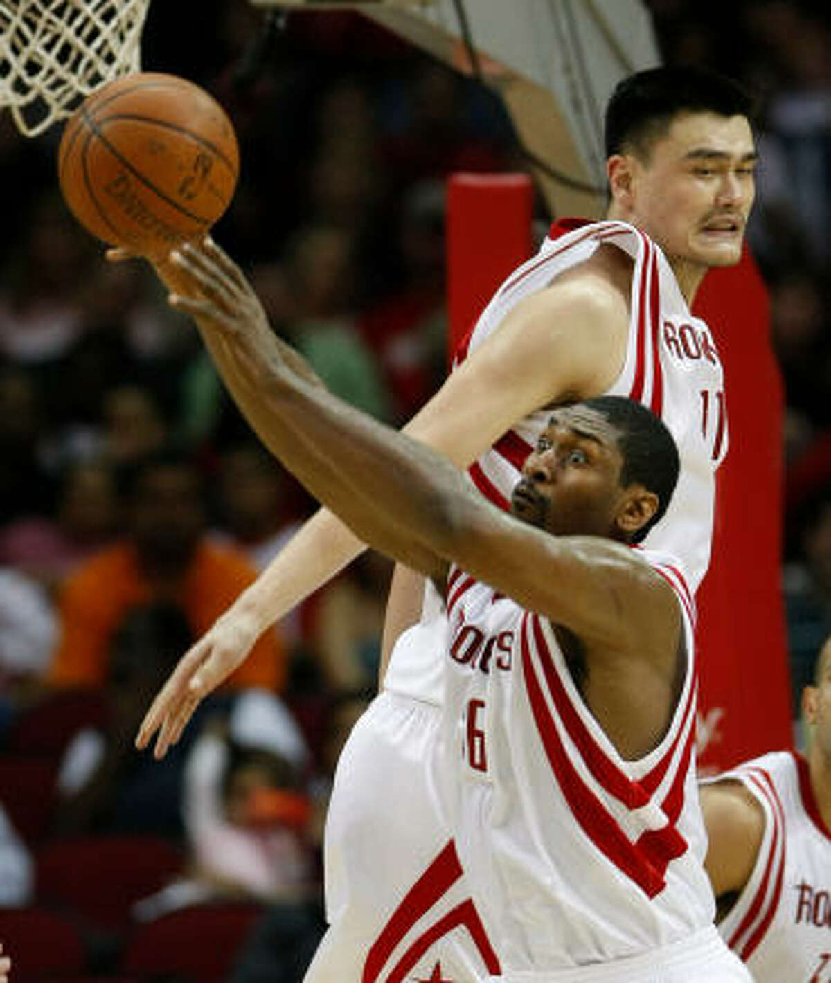 While regarded as two of the Rockets' best players, neither Ron Artest, bottom, nor Yao Ming, top, have established themselves as the team's singular leader.