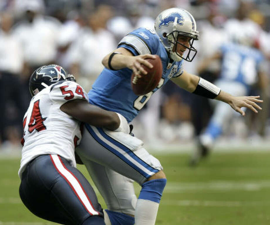 Detroit Lions quarterback Dan Orlovsky got some rough treatment from Texans linebacker Zac Diles in October. Now, Orlovsky is a Texan. Photo: Brett Coomer, Chronicle