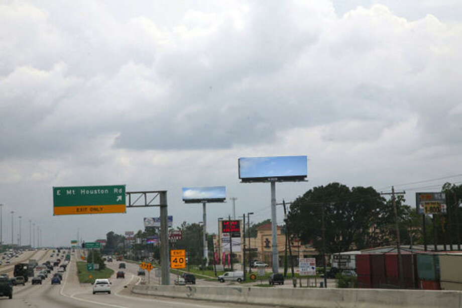 Artist Karyn Olivier is replacing 13 billboard ads across Houston with life-size photographic representations of what drivers would see if the advertising did not exist: sky, buildings, homes, trees and other elements of the environment. Photo: Dabfoto Creative