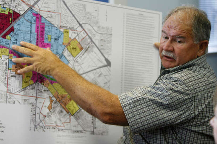 Gene Bane, zoning administrator and director of building permits and nuisance abatement for Stafford, talks about the business park in the city during a meeting in Mayor Leonard Scarcella's office last week. Photo: Julio Cortez, Chronicle