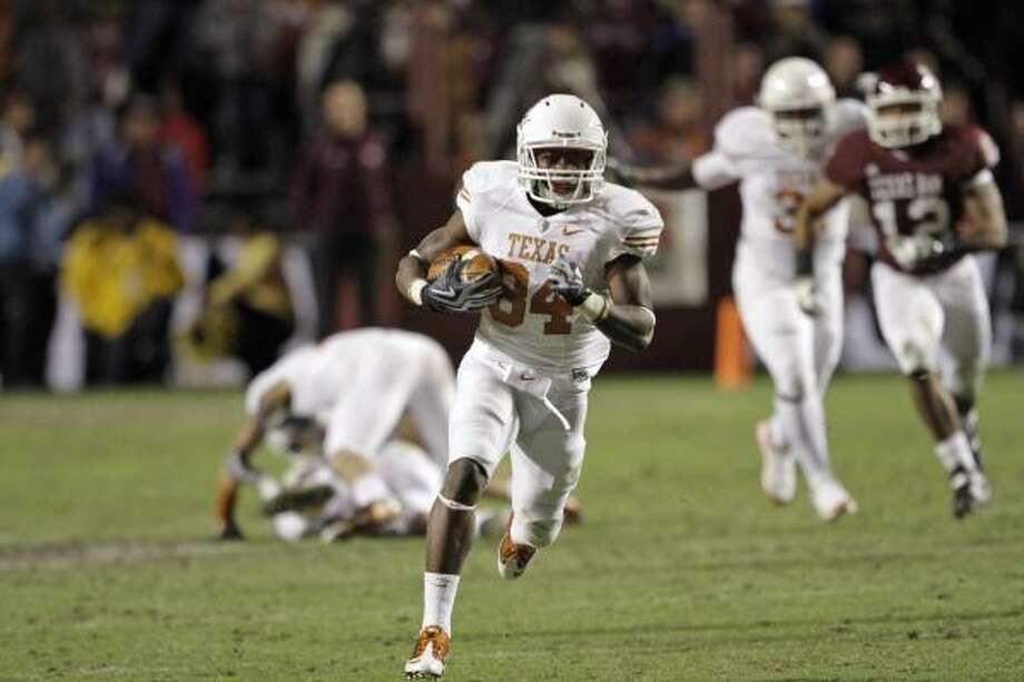 Texas receiver Marquise Goodwin returned a kickoff 95 yards for a touchdown at A&M. Photo: David J. Phillip, AP