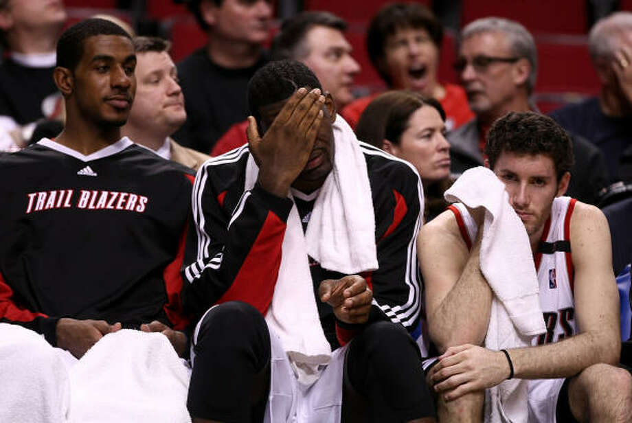 Though despondent during their 27-point loss to the Rockets on Saturday, Portland's LaMarcus Aldridge, from left, Greg Oden and Rudy Fernandez aren't throwing in any towels. Photo: Jonathan Ferrey, Getty Images