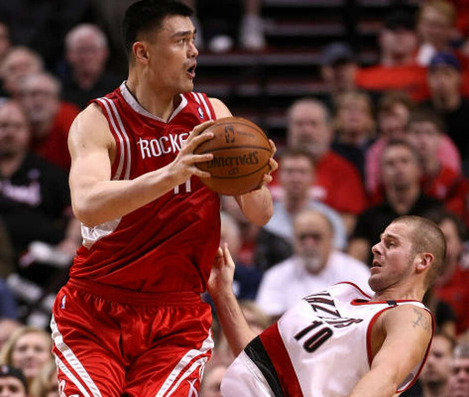 The Trail Blazers will do whatever it takes tonight to prevent Rockets center Yao Ming, left, from having another red-hot outing. Photo: Jonathan Ferrey, Getty Images