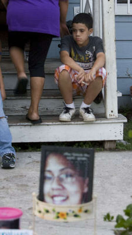 Fourteen Year Old Fernando Meza Mourns The Death Of His Sister Alma As