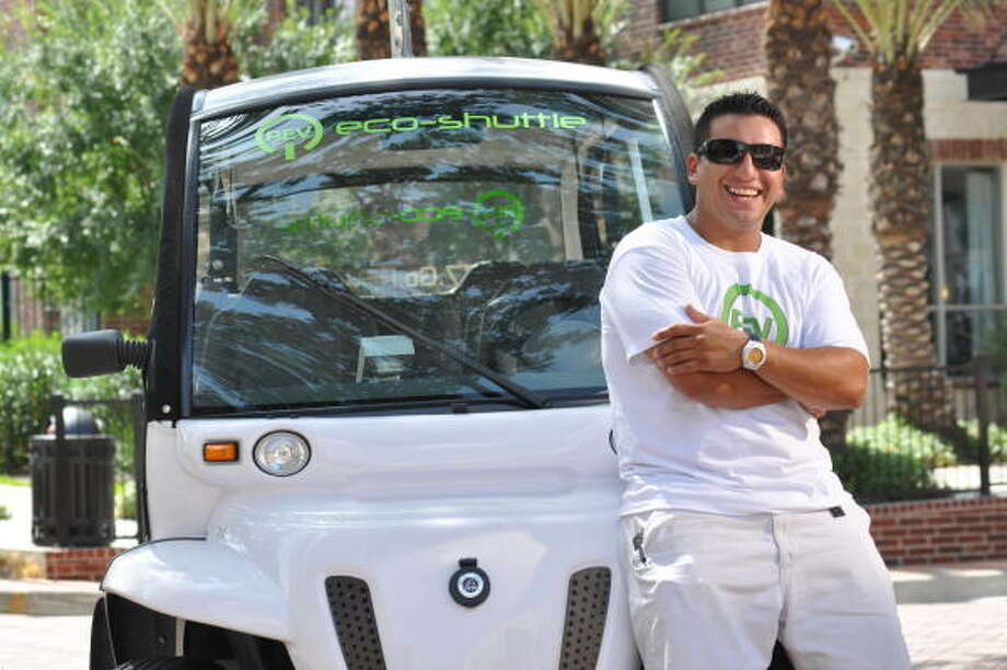 Erik Ibarra's company, Rev Houston, has three small electric cars on the streets of downtown and Midtown picking up passengers who tip instead of pay a metered fare. Photo: Steven Oster