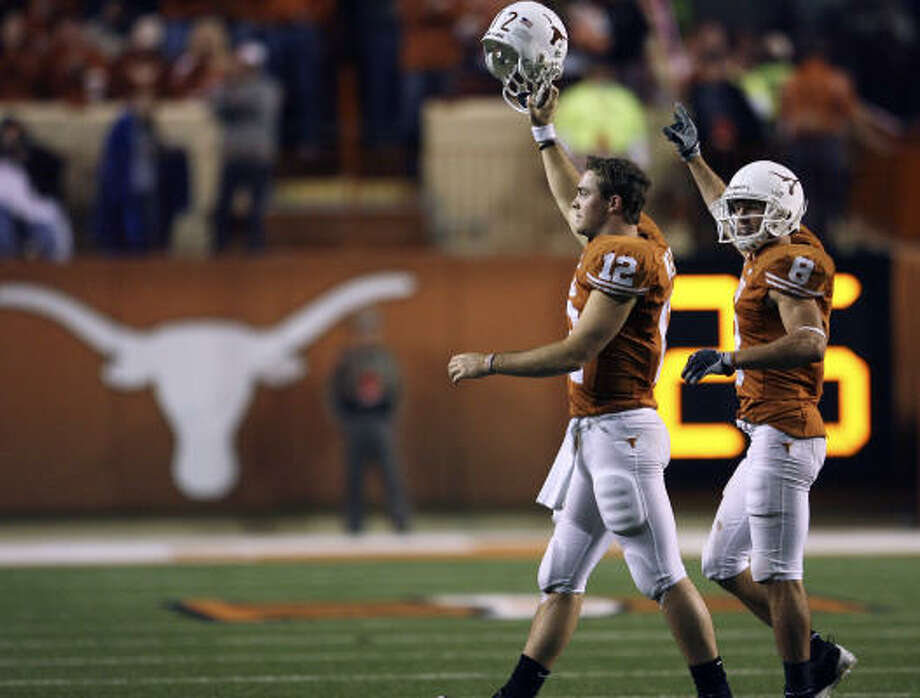 Colt McCoy, left, and Jordan Shipley can walk off the field as national champions in January, but a win against Nebraska is a vital step. Photo: TOM REEL, SAN ANTONIO EXPRESS-NEWS