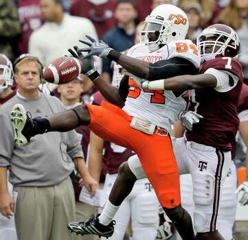 Texas A&M cornerback Terrence Frederick (7) breaks up a pass intended for Oklahoma State wide receiver Hubert Anyiam (84) during the second quarter of an NCAA football game Saturday, Oct. 10, 2009 in College Station, Texas. Photo: AP