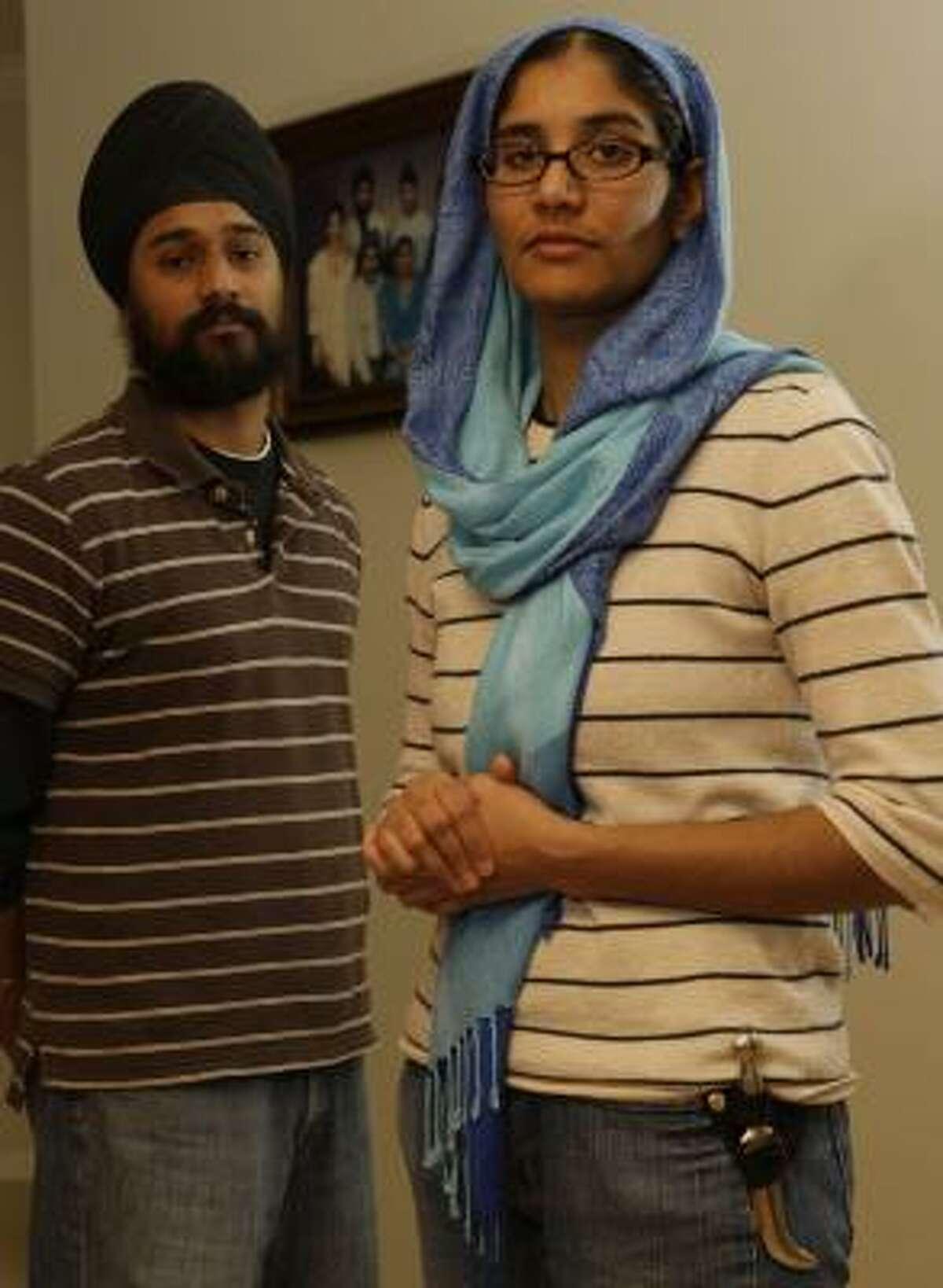 Kawaljeet Kaur Tagore wears the Kirpan; her brother Ramandeep Singh covers his uncut hair with a Sikh turban.