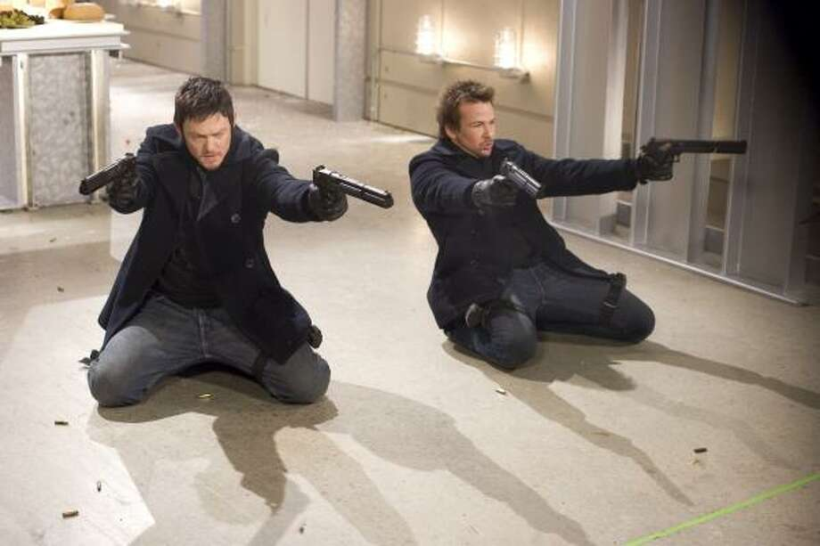 "Norman Reedus, left, and Sean Patrick Flanery are shown in a scene from ""The Boondock Saints II: All Saints Day."" Photo: Apparition Films"
