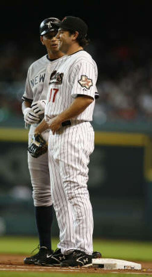 Lance Berkman, right, a player who denies using performance-enhancing drugs, chats with Alex Rodriguez, a player who owned up to his use, during a 2008 game at Minute Maid Park. Photo: Karen Warren, Houston Chronicle