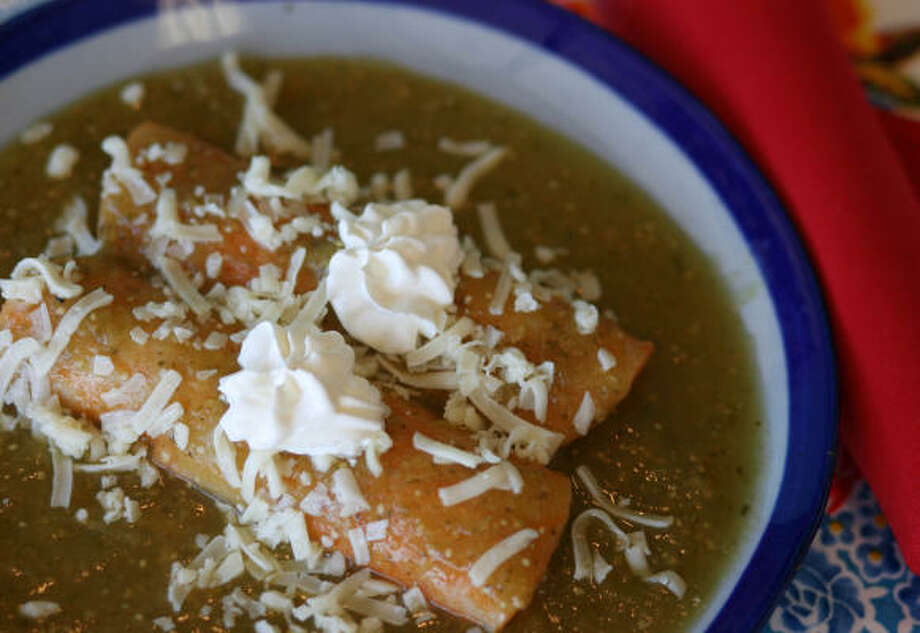 Enchiladas Verdes are a popular variation on enchiladas. The how-to is the same; just substitute a green sauce for red. Photo: CHRONICLE FILE