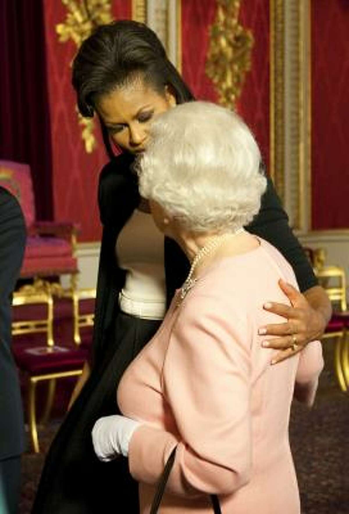 First lady Michelle Obama returns a touch from Queen Elizabeth II.