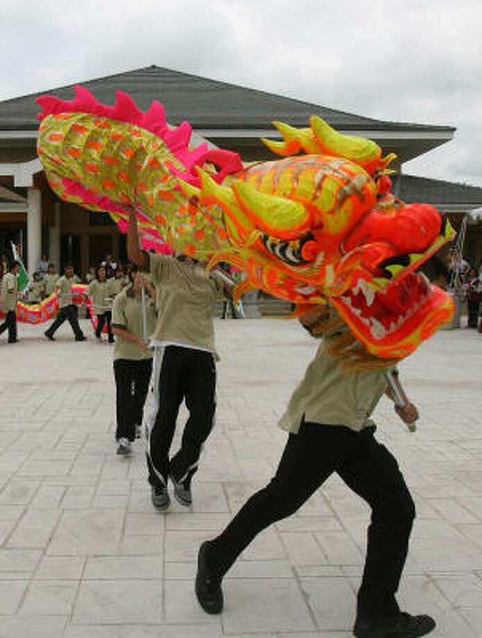 The Texas Buddha Association Youth Group performs the Dragon Dance outside the Meditation Center at the American Bodhi Center. Photo: MAYRA BELTRAN:, CHRONICLE