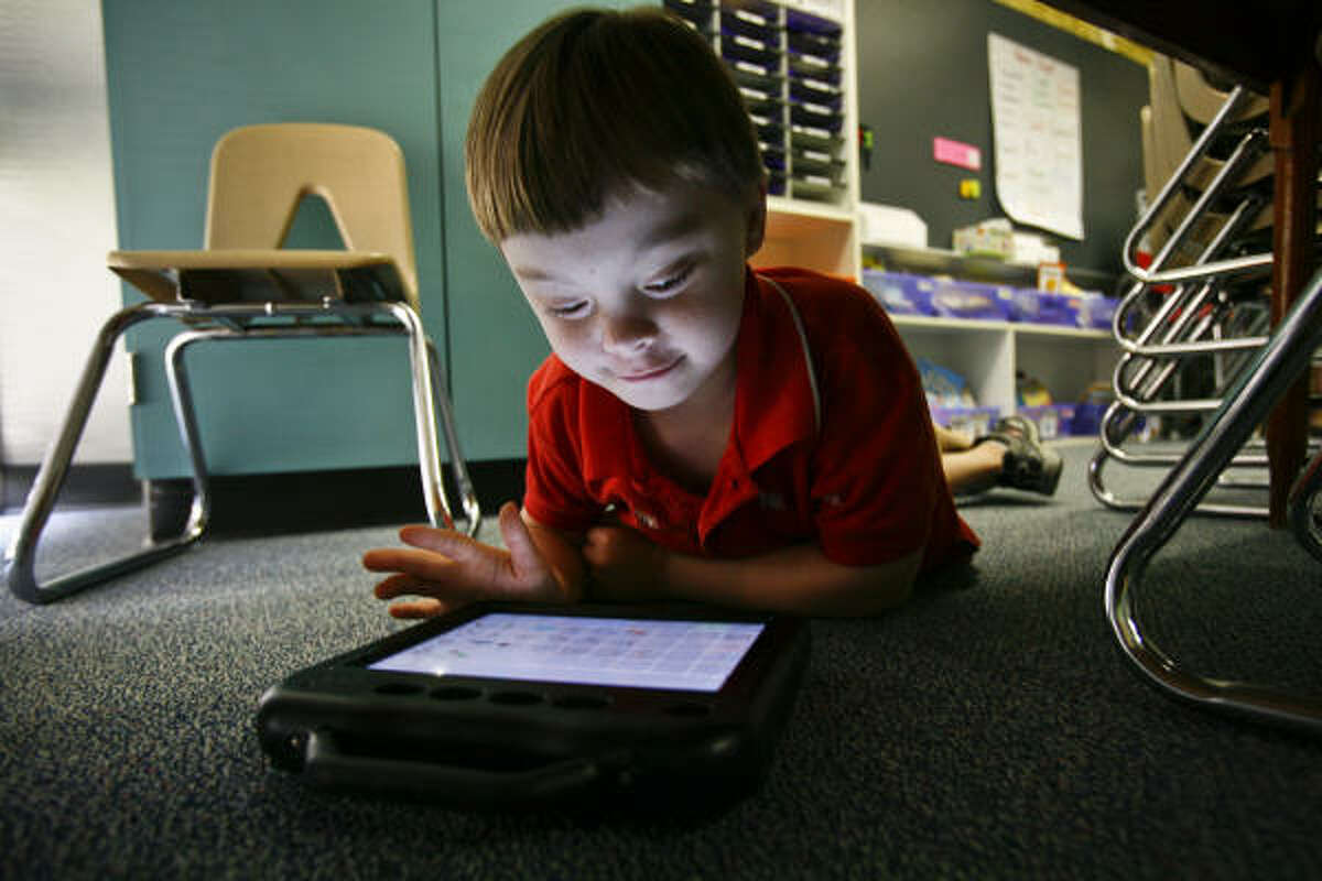 Brookwood Elementary first-grader Peter Bernay's voice-output device helps him articulate his thoughts. Clear Creek ISD put stimulus funds into more of these special education tools.
