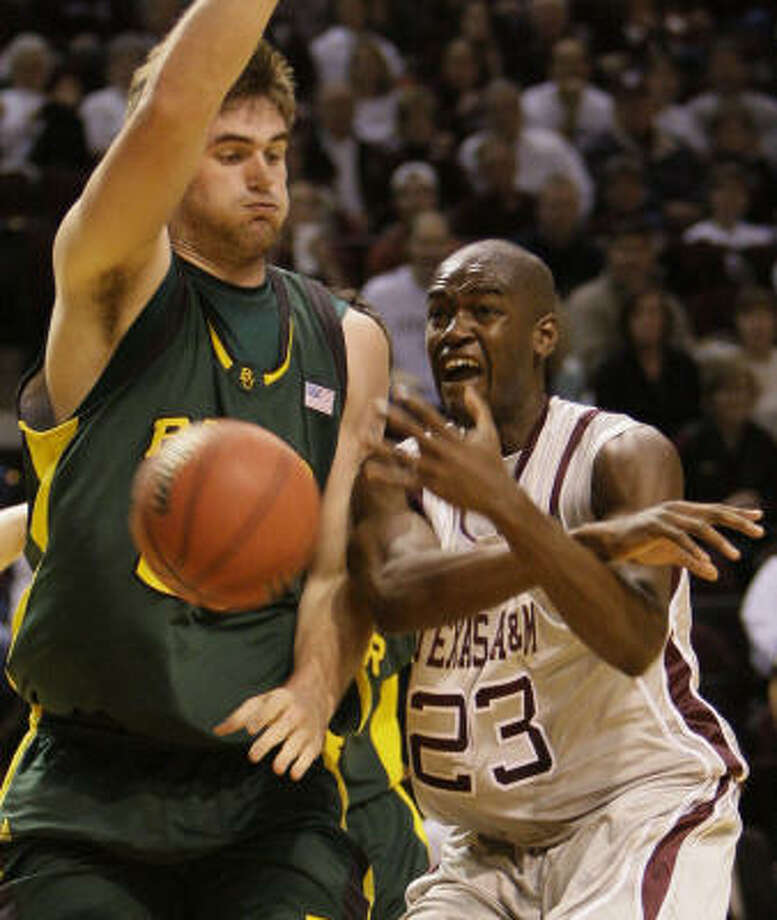 Baylor center Josh Lomers (left) refuses to let asthma get the best of him. Photo: Melissa Phillip, Houston Chronicle