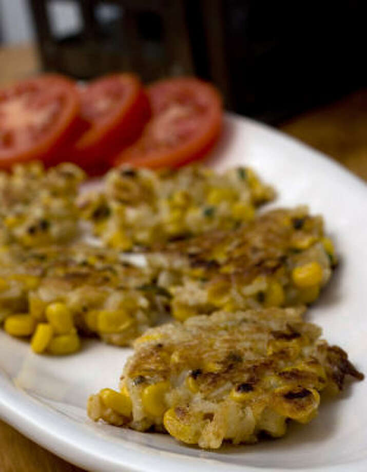 Ingredients such as corn and Creole ceasonings work well in savory versions of calas. Photo: ASSOCIATED PRESS FILE