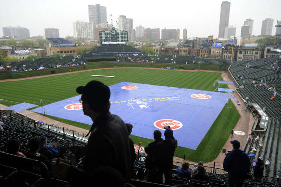 Fans start to leave Wrigley Field as the Astros' game with the Cubs on Friday. The game has been rescheduled for July 30. Photo: David Banks, AP
