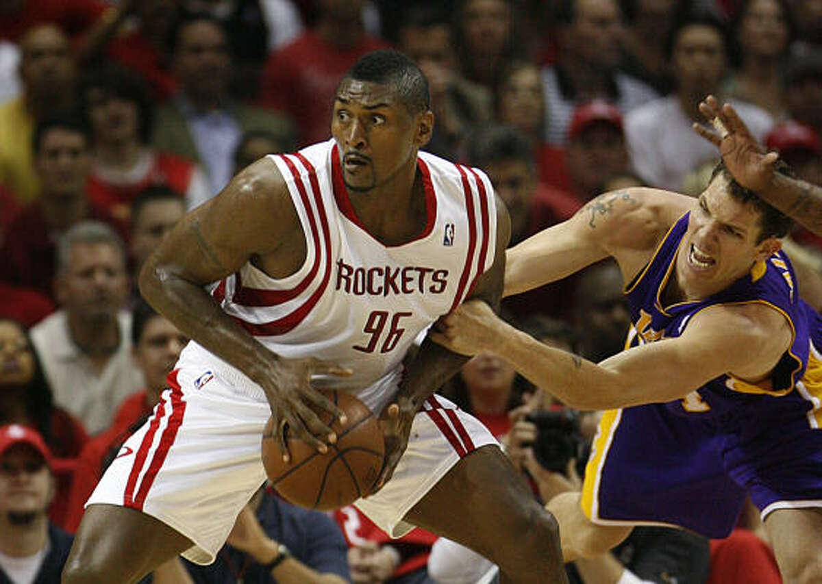 With Ron Artest, left, no longer in the mix, the Rockets signed Trevor Ariza Thursday night.