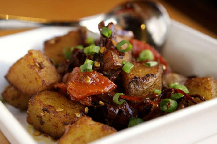 Patatas Bravas is a scrumptious dish consisting of crispy potatoes seasoned with guajillo chile paste and garlic. Photo: Brett Coomer, Chronicle