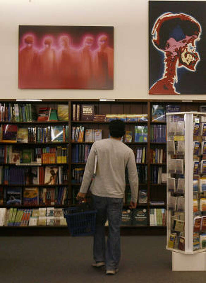 Rick Diaz, a student at Houston Community College, peruses the shelves at Majors Books on Thursday. He's studying to be a dental hygienist. Photo: Mayra Beltran, Chronicle