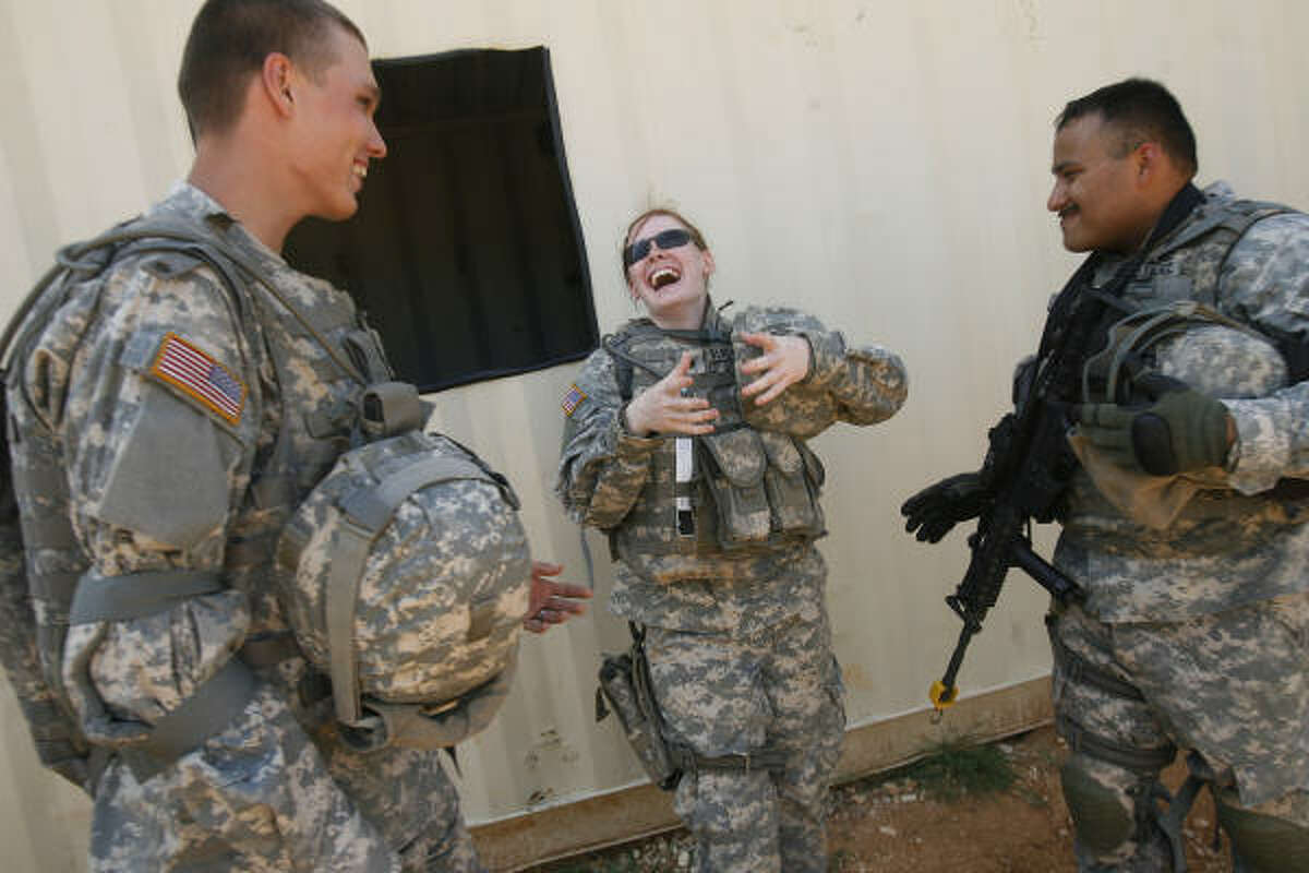 Pfc. James Houston of Clear Lake, from left, Spc. Cortney Blackshear of Humble and Spc. Antonio Hernandez of Houston take a break during urban operations training.