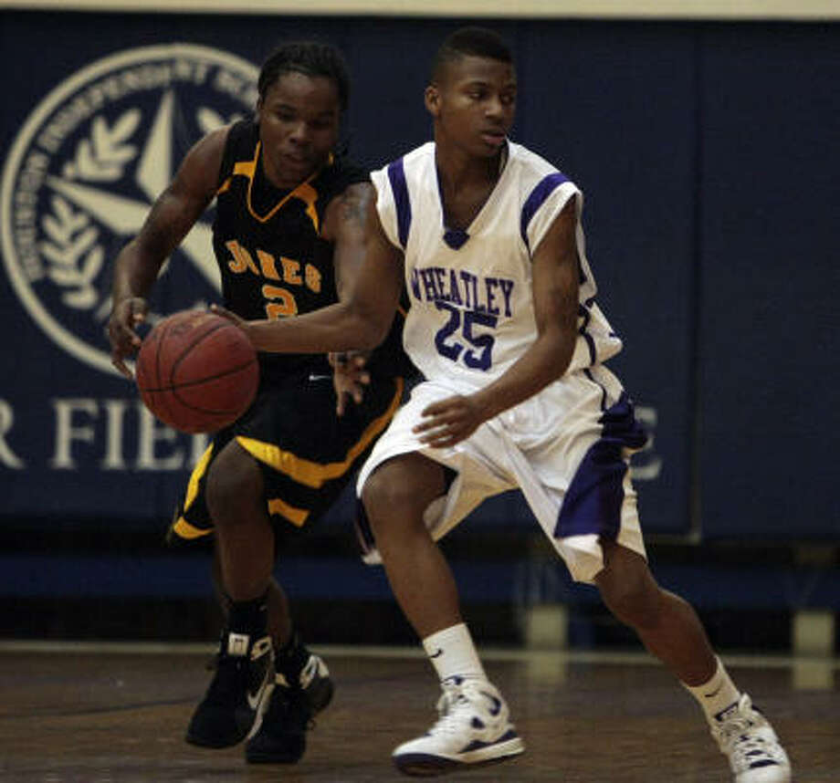 Wheatley's Kendron Ginn (25) has the ball knocked away by Jones' Kendre Bailey on Tuesday. Photo: Bob Levey, For The Chronicle