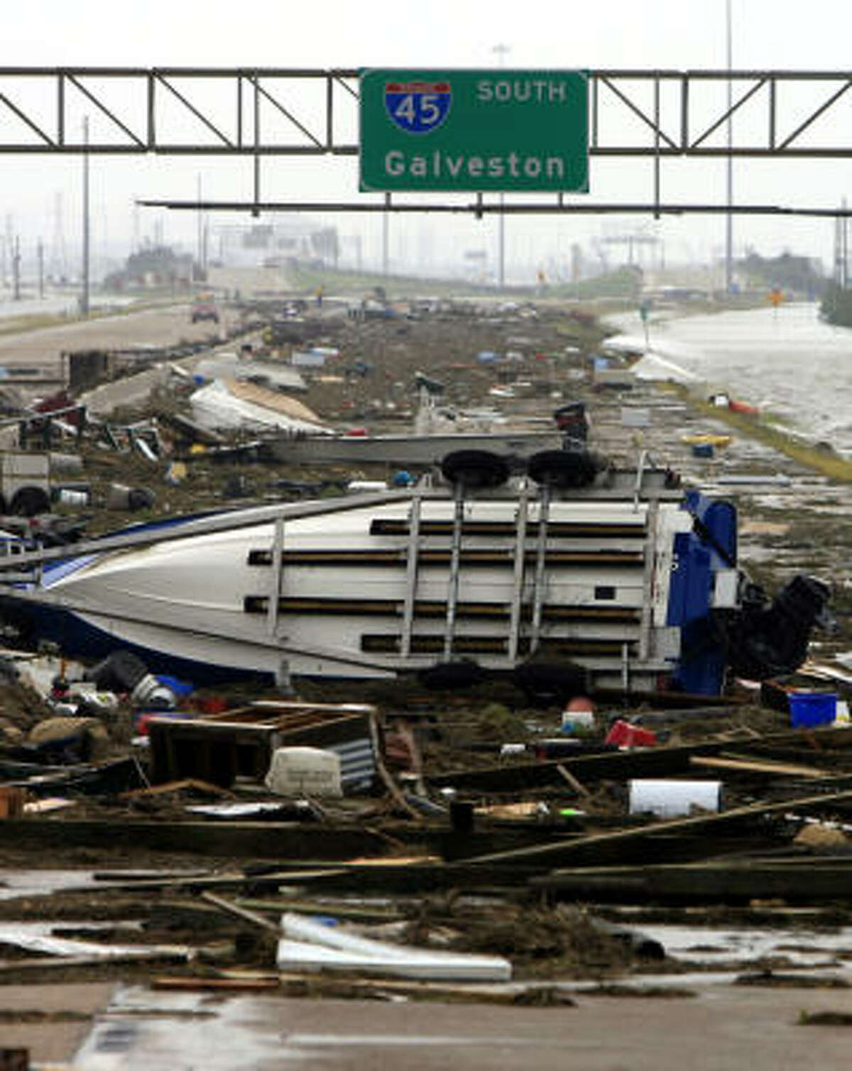 In this photo taken just after the storm, debris blocks Interstate 45. Ike was a Category 2 storm on the Saffir-Simpson scale.