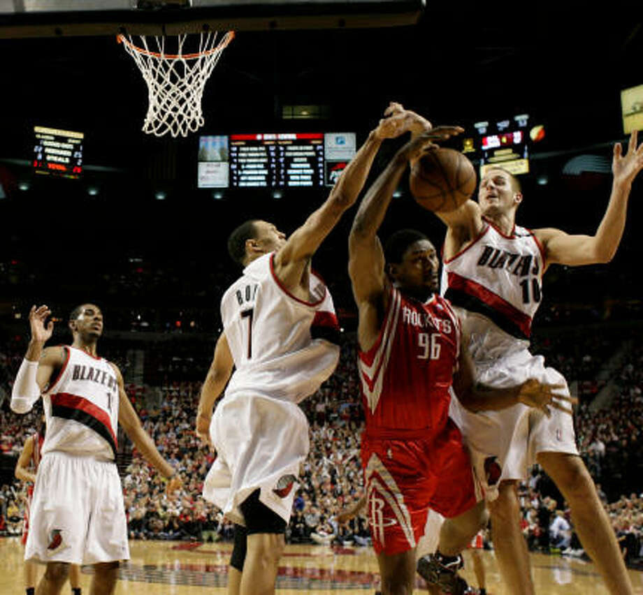 Defended by the likes of Portland's LaMarcus Aldridge (left), Brandon Roy (7) and Joel Przybilla , Rockets guard Ron Artest found the scoring tough in Game 5. Artest was 3-of-9 from the field in his 10-point night. Photo: Nick De La Torre, Chronicle