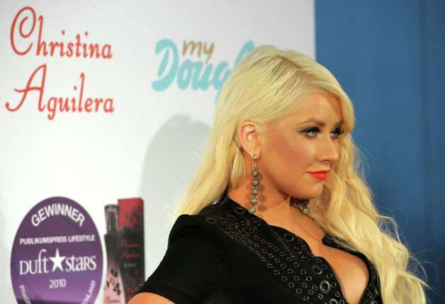 MUNICH, GERMANY - JULY 13:  Singer Christina Aguilera presents the new fragrance 'Royal Desire' at the Upside East Lounge on July 13, 2011 in Munich, Germany. Photo: Hannes Magerstaedt, Getty Images / 2011 Getty Images