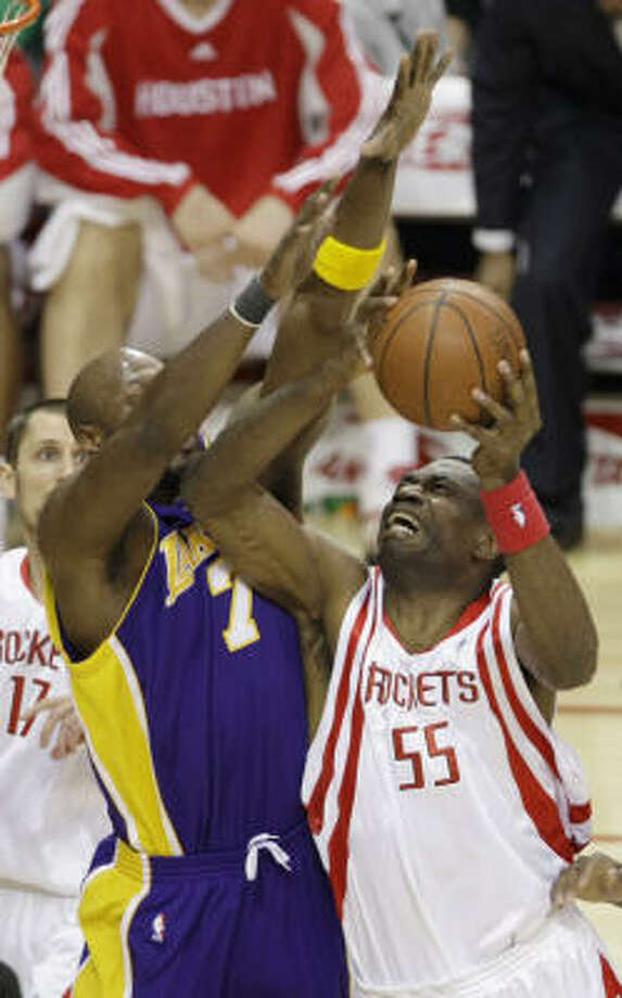 Dikembe Mutombo sees his first action of the season against the Lakers on Tuesday night. Photo: Brett Coomer, Chronicle