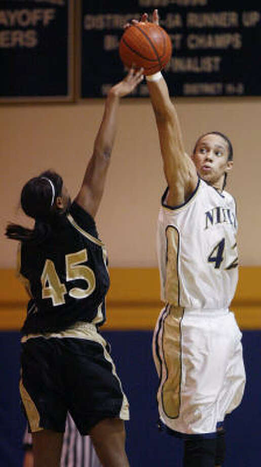 Nimitz post Brittney Griner, right, blocks a shot put up by Eisenhower forward Clarissa Moore during the first half of a District 19-5A game at Nimitz on Friday. Photo: Brett Coomer, Chronicle