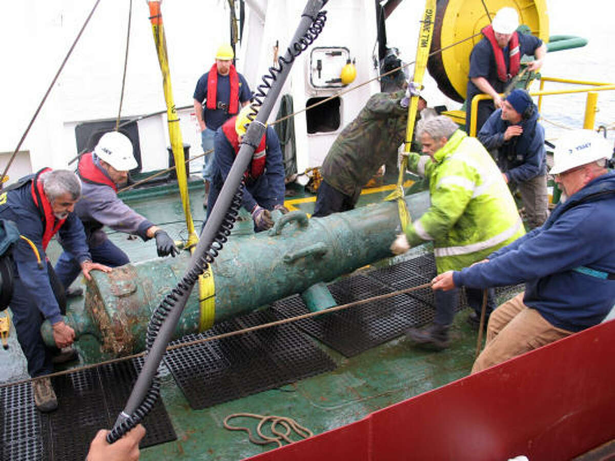 HUGE FIND: The 42-pounder bronze cannon recovered from the shipwreck site of HMS Victory is lifted from the water for placement on the deck of the Odyssey Explorer. Florida-based Odyssey Marine Exploration said it discovered the HMS Victory last year.