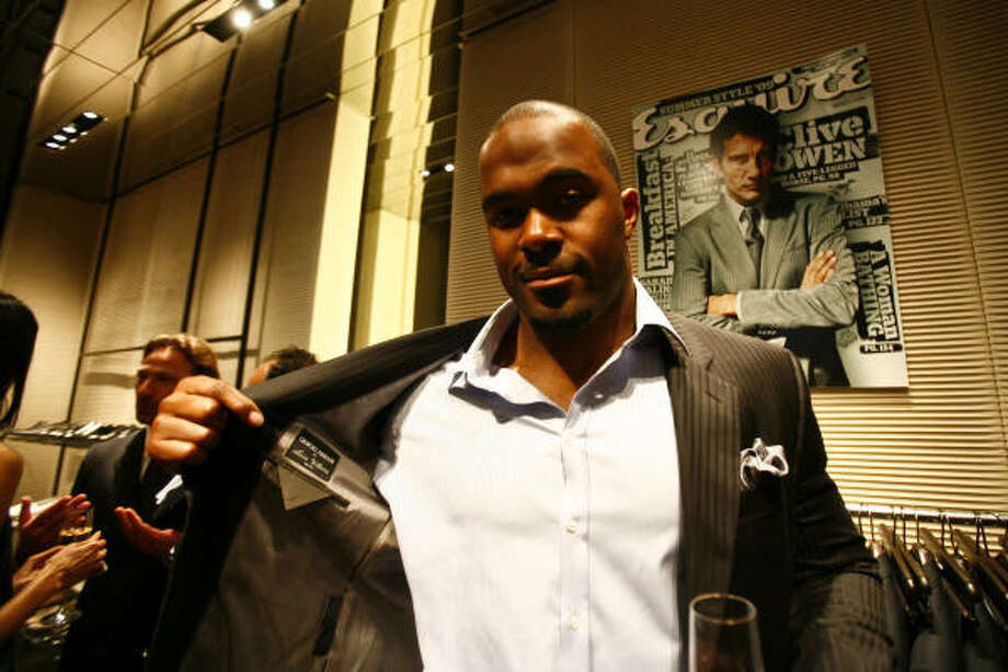 The Houston Texans' Mario Williams hosts a made-to-measure suit event at the Armani store in the Galleria. Ten percent of sales benefited the Center for Citizen Leadership. Photo: Michael Paulsen, Chronicle