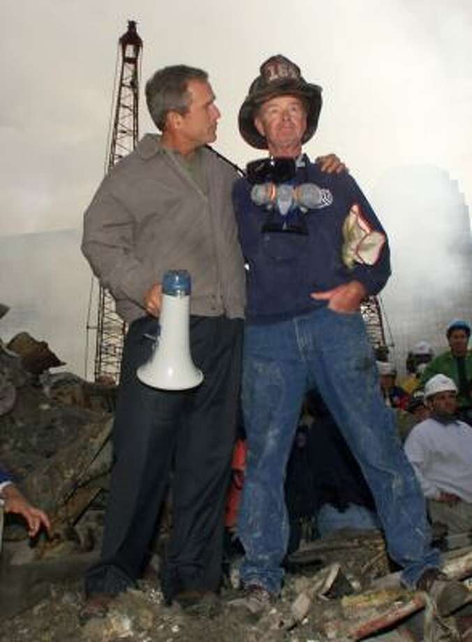 President George W. Bush rallied the nation after the Sept. 11, 2001, attacks with this appearance at Ground Zero with New York firefighter Bob Beckwith. Photo: DOUG MILLS, ASSOCIATED PRESS