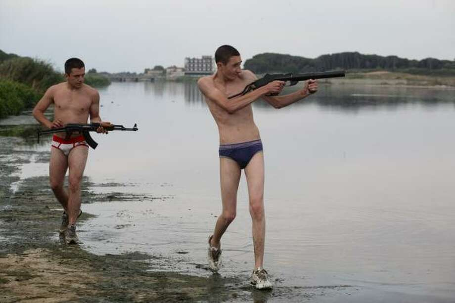 Ciro, left, and Marco are two men obessed with Scarface in the Italian film, Gomorrah. Photo: Mario Spada, AP