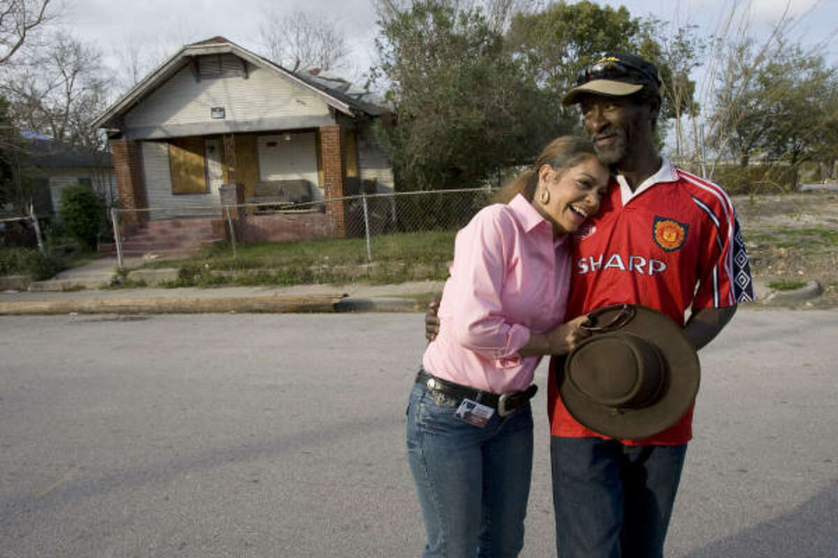 Kathryn Griffin greets an old friend named C.C. in front of a vacant house where she would buy and use crack in the Third Ward. Griffin was a drug addict for about 20 years before joining the Success Through Addiction Recovery program.