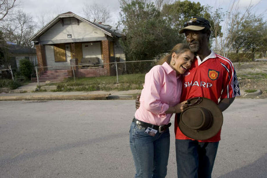 Kathryn Griffin greets an old friend named C.C. in front of a vacant house where she would buy and use crack in the Third Ward. Griffin was a drug addict for about 20 years before joining the Success Through Addiction Recovery program. Photo: Johnny Hanson, Chronicle