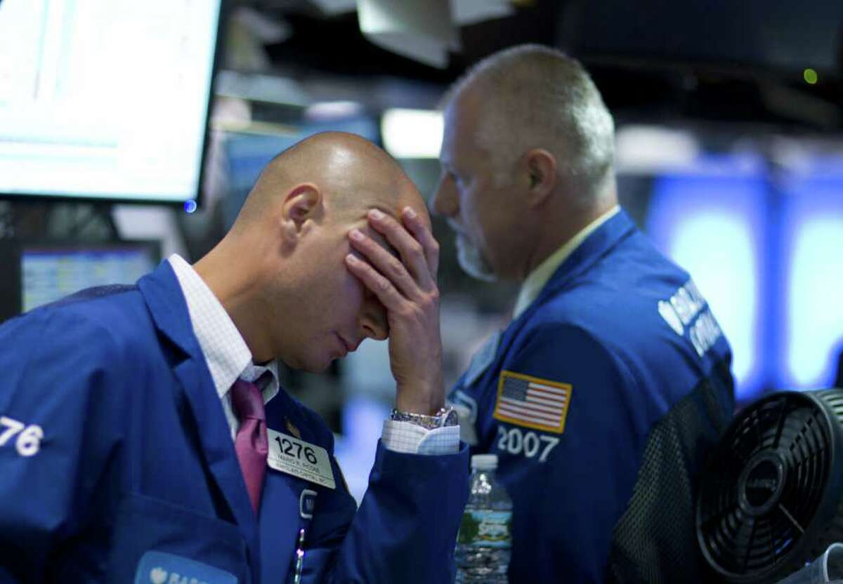Traders work on the floor of the New York Stock Exchange on Thursday, Aug. 4, 2011 in New York.