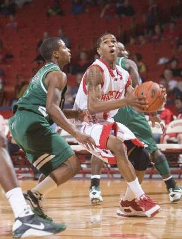 UH guard Zamal Nixon (right) scored 23 points in the Cougars' 83-64 win over Tulane on Saturday. Photo: Bob Levey, For The Chronicle