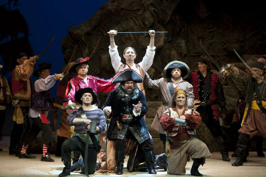 Pirate King, played by Ralph Katz, leads his mates in The Pirates of Penzance at the Wortham Center. The Gilbert and Sullivan Society of Houston produced the show. Photo: Nathan Lindstrom