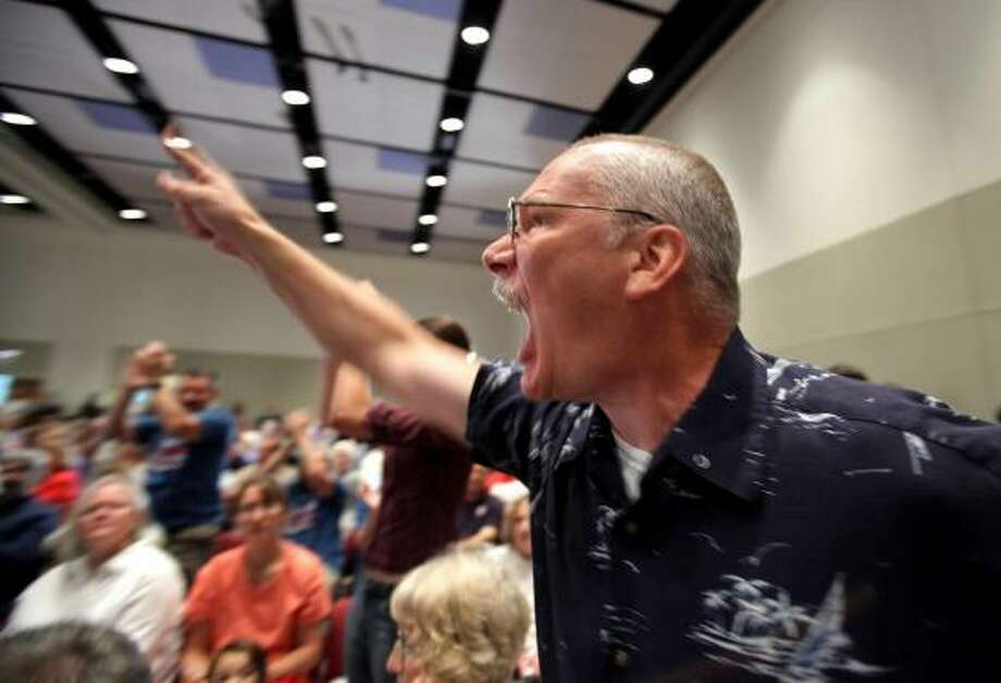 Randy Hook, 50, (of Hopewell, Pa., near Pittsburgh) yells at Sen. Arlen Specter during a town hall meeting this week. Photo: Carolyn Kaster, AP