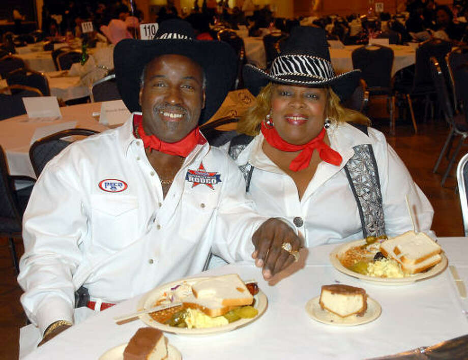 Darnell and Betty Mosley were among the 1,500 guests dining on barbecue from Lenox Barbecue & Catering. Photo: Dave Rossman, For The Chronicle